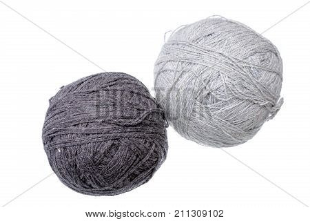 Two woolen balls isolated on white background