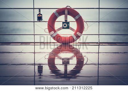 Cruise Ship Wet Deck and the Lifebuoy Ling. Rainy Cruise Weather.