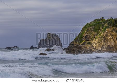 Glasshouse rocks at Narooma ocean coastline in stormy weather