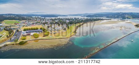 Aerial panorama of Narooma residential area and holiday park. NSW Australia