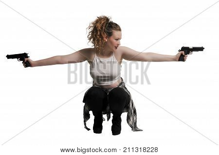 Beautiful young woman with a couple of pistols