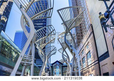 CALGARY, ALBERTA, CANADA - AUGUST 9, 2017 Steel Galleria Trees Stephen Avenue Walking Street Downtown Calgary Alberta Canada. Galleria trees installed in 2000 to reduce wind