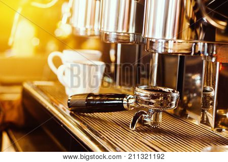 coffee machine. coffee machine preparing fresh coffee into white coffee cups at restaurant bar or coffee shop. warm light effect