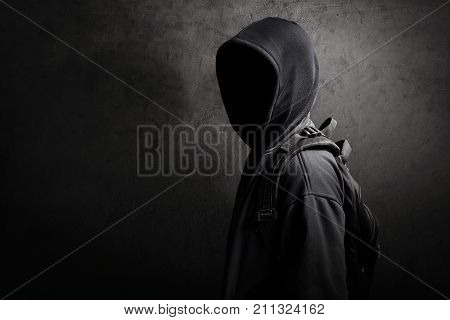 Mysterious unknown hacker standing on the street