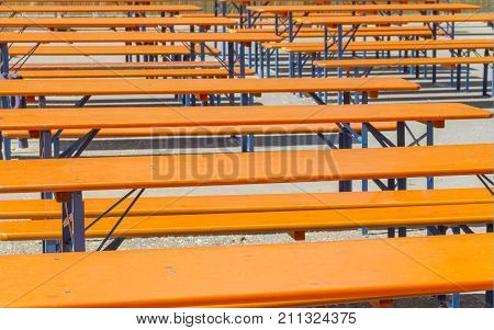 lots of empty beer benches and tables