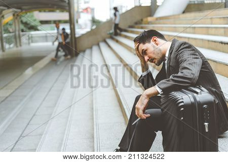 Unemployed businessman stress sitting on stair concept of business failure and unemployment problem work life balance. poster