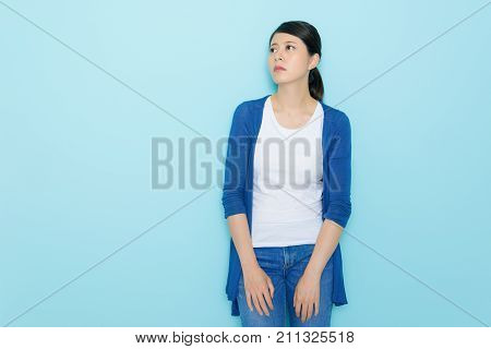 Unhappy Sad Teenager Standing In Blue Background