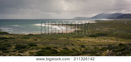 Panoramic view of the seashore looking down from a hiking trail on a mountain near Cape Point, South Africa