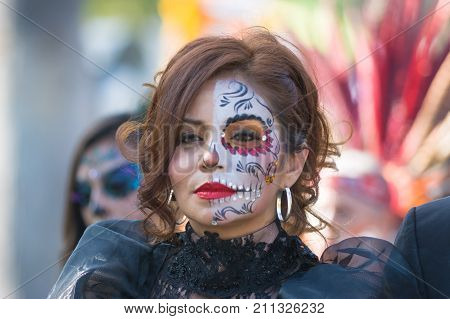 Woman With Sugar Skull Makeup During Day Of The Dead