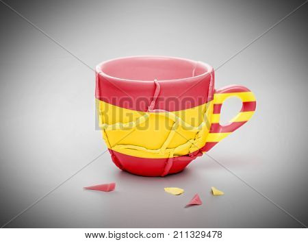Glued Broken Cup, Patterned With Flag Of Spain And Flag Of Catalonia, Independence Concept