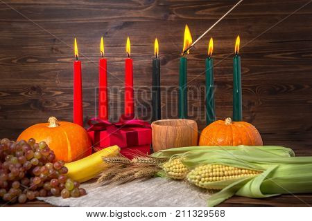 Ignition Of Kwanzaa Traditional Candles, Festival Concept With Gift Box, Pumpkins, Ears Of Wheat, Gr