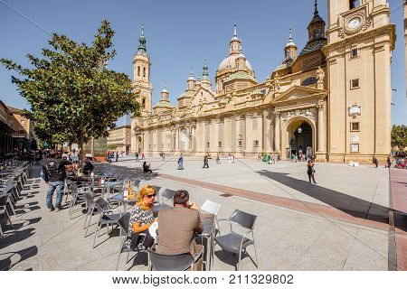 ZARAGOZA, SPAIN - August 20, 2017: View on the cathedral of Our Lady of the Pillar with people on the central square in Zaragoza city, Spain