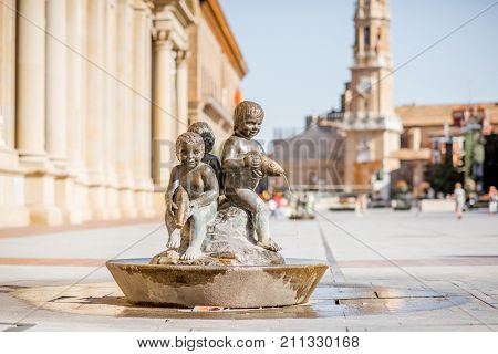 ZARAGOZA, SPAIN - August 20, 2017: View on the fountain on the Pillar square near the cathedral of Our Lady of Zaragoza city in Spain