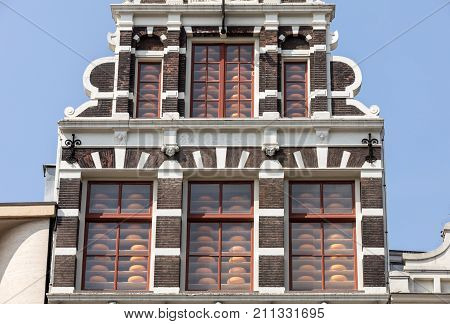 Typical gabled houses on Damrak street in Amsterdam Holland Netherlands