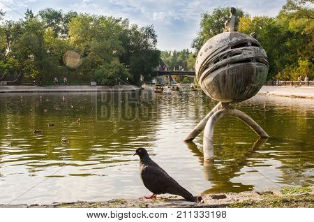 Lazar Globa Park. Warm summer evening in the city park. Dnipro City, Ukraine September 10, 2017: the lake of the Central Park. Central Park is the most visited and most popular urban park in the city with 1 million visitors.