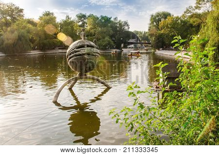 Lazar Globa Park. Warm summer evening in the city park. Dnipro City Ukraine September 10 2017: the lake of the Central Park. Central Park is the most visited and most popular urban park in the city with 1 million visitors.