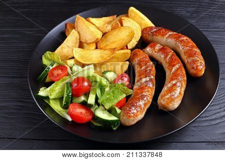 Grilled Sausages, Baked Potatoes And Salad