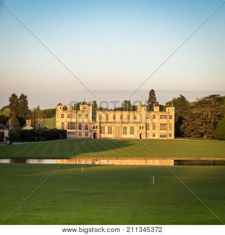 Saffron Walden UK - 16 MAY 2016: A dusk view of the facade of Audley End House a 17th Century country house outside Saffron Walden Essex England.