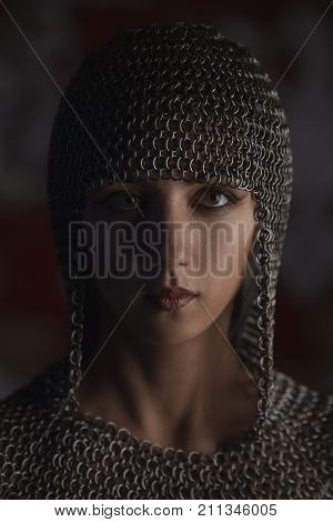 Portrait Of Beautiful Medieval Girl Warrior In A Chainmail Hood.