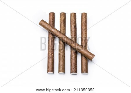 Macro Of Five Cigarillos Arranged As A Tally Isolated On White Background