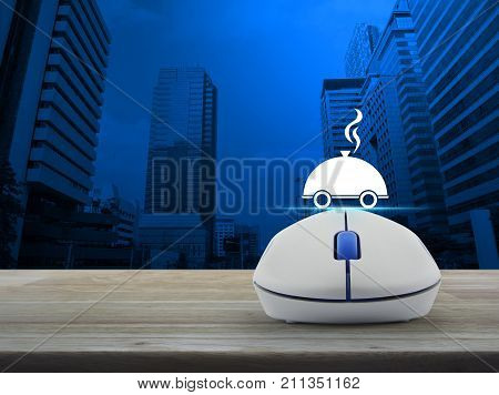 Restaurant cloche flat icon with wireless computer mouse on wooden table over modern office city tower Food delivery concept