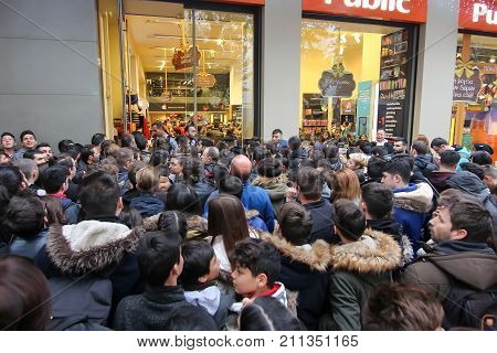 People Wait Outside A Department Store During Black Friday Shopping Deals