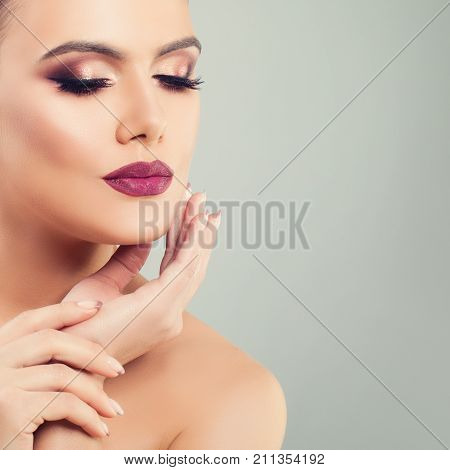 Fashion Portrait of Beautiful Model Woman with Perfect Makeup. Beautiful Female Face Closeup