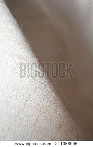 Detail of a ligh  beige linen sheet texture