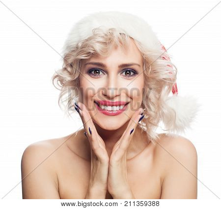 Smiling Christmas Woman in Santa Hat Isolated on White Background . Cute Surprised Woman Christmas Concept