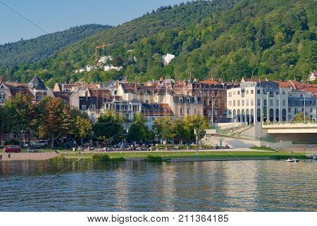 View on the waterfront of the Neckar, a favorite recreation place of citizens and guests of the city. Heidelberg, Germany - September 3 2017.