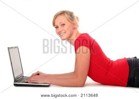 Girl Lying On Floor Using Laptop