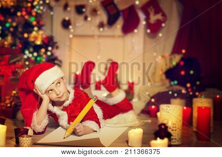 Child Writing Christmas Letter Happy Kid Write Wish List to Santa in Decorated Xmas Home Room