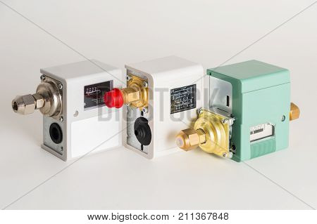 three Pressure switch in the pipeline, for monitoring and balancing the pressure in the pipeline. A new relay on a gray background