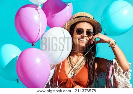 Bohemian Girl With Helium Balloons