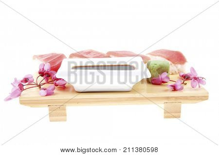 Japanese Cuisine - Set of Nigiri sushi topped with raw Tuna (maguro) . on wooden board . isolated over white background