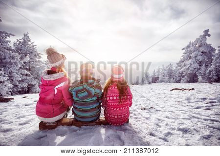 Ski, winter, snow and fun - family enjoying winter together