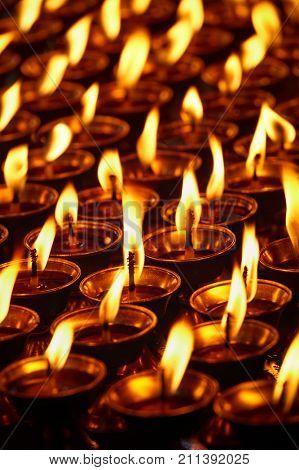 Burning candles in Buddhist temple. Dharamsala, Himachal Pradesh