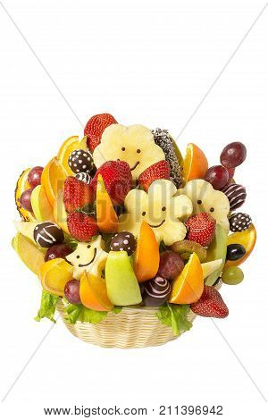 Gift basket with fruits and sweets. Basket with fruits and berries in chocolate isolated on white background. Handmade. Strawberries and grapes, citrus, apple, kiwi and pineapple.