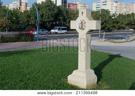 Cross on the street in the city of Alicante, Spain