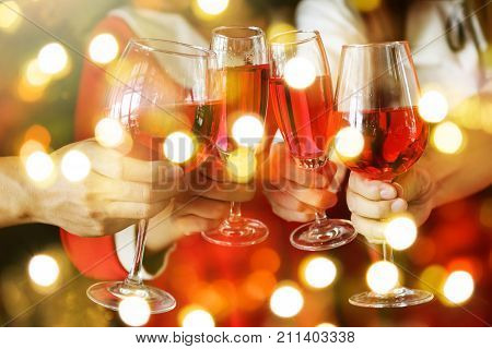 Toasting Red Wine With Light Bokeh