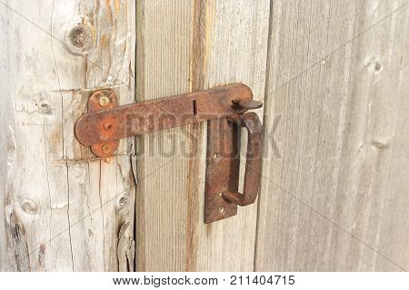 Rusty metallic vintage door handle and latch