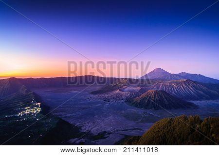 Mount Bromo volcano (Gunung Bromo) at sunrise with colorful sky background in Bromo Tengger Semeru National Park East Java Indonesia.