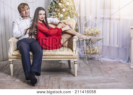 Beautiful Young Couple Man And Woman Together In The Happy Christmas