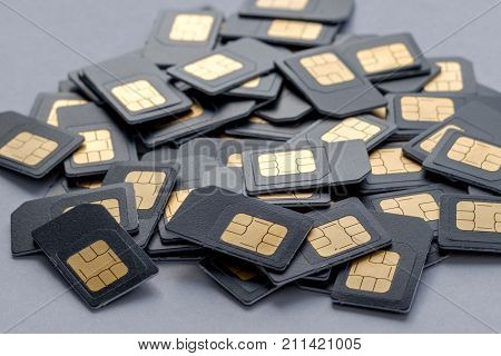 many SIM cards side view with the gray card in large quantity