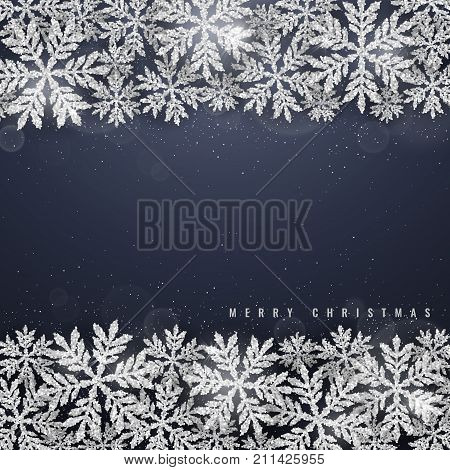 Christmas and new year dark blue background with christmas frame made of silver glittering snowflakes on dark background. Merry Christmas greeting card