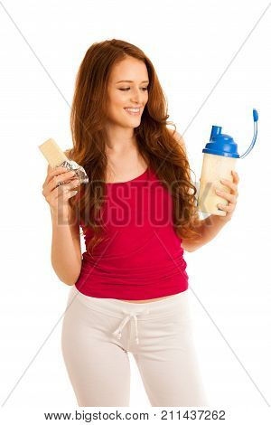 Attractive Beautiful Sporty Woman Eats Protein Bar And Drinks Protein Shake