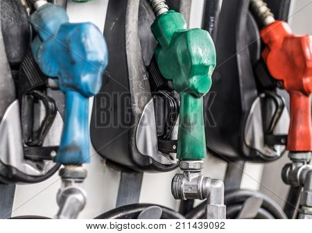 Gasoline and diesel pump nozzles in a gas station closeup. Filling gun, gas refueling nozzle, gasoline pump