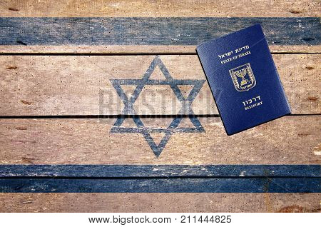 Israel passport on the table and flag