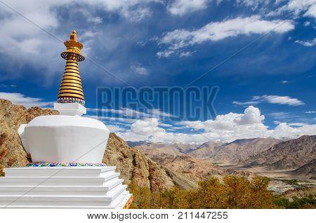 Buddhist stupa near Hemis monastery with dramatic sky, Leh Ladakh, India
