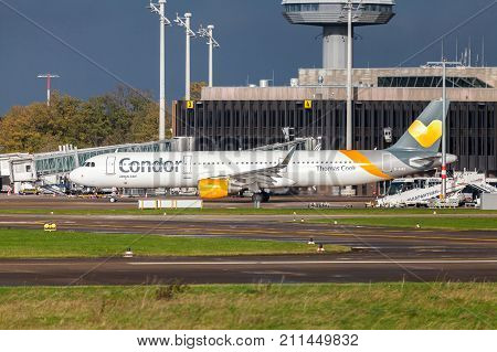 LANGENHAGEN / GERMANY - OCTOBER 28 2017: Airbus A 321 from airline Condor drives on airport to the runway.